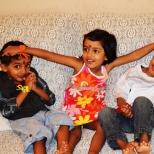 Tisha blessing her brothers, Otu and Renne