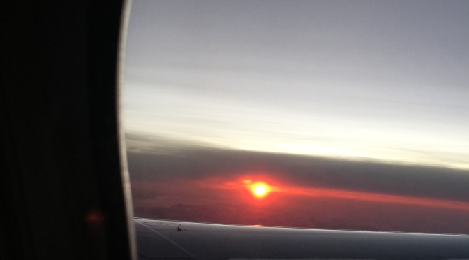 Silent Sunday – Rising Sun From Plane Window