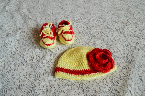 Crocheted Baby Booties and Caps